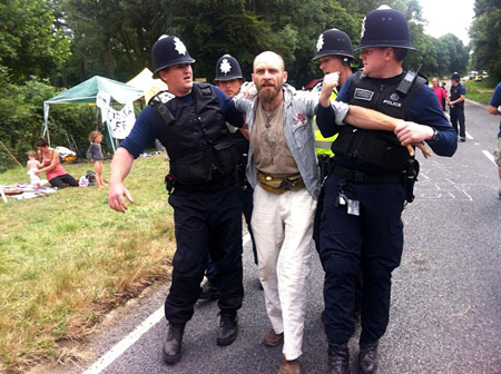 A protestor is removed by police. Photo Frack-Off