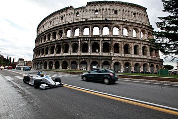 A Formula E car races along the streets of Rome