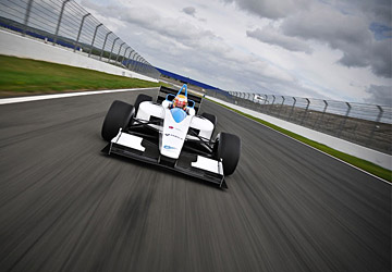 A Formula E car driving on a racing track
