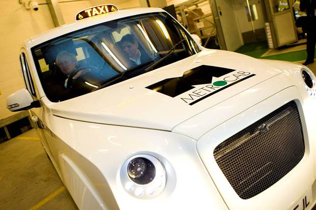 The Metrocab, with Mayor Boris Johnson at the wheel